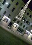 In the square, diagonally