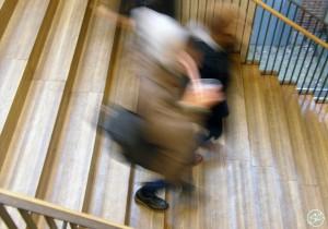 Figures descending a staircase