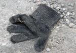 Frosted woolen glove, in car park, Kvarteret Bulten, Gothenburg, Sweden 9 Mar '11 08.00
