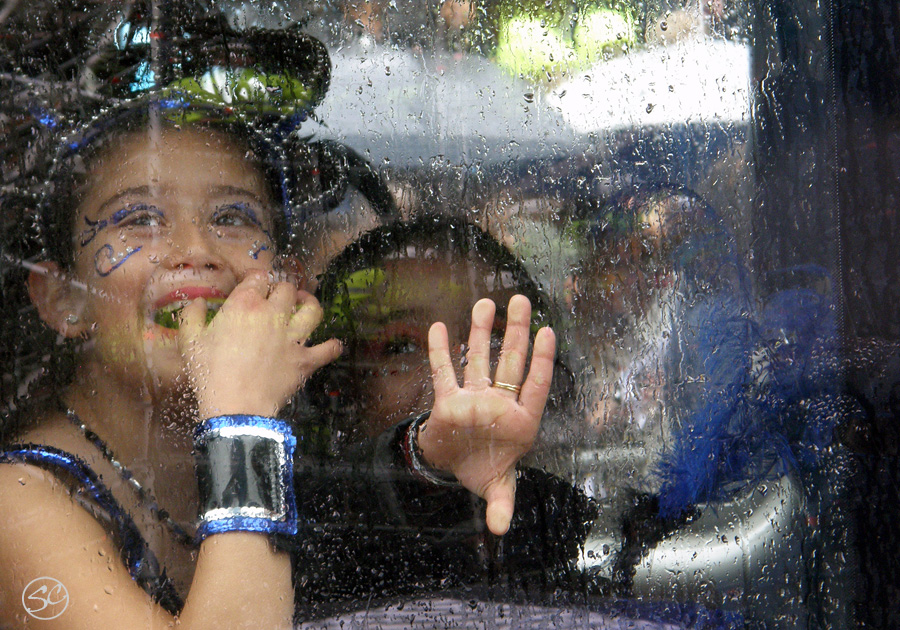 Hammarkullen Carnival kids through a rainy window