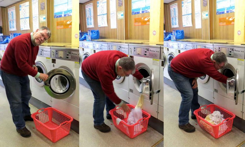 Laundry: Loading a washing machine