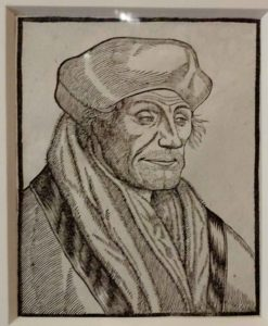 Erasmus House: Etching of a sly looking Erasmus