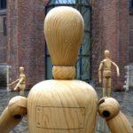 Giant artist's mannequins outside Mechelen cultural centre Minderbroedergang