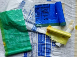 Little brown bag - White green yellow blue plastic rubbish bags