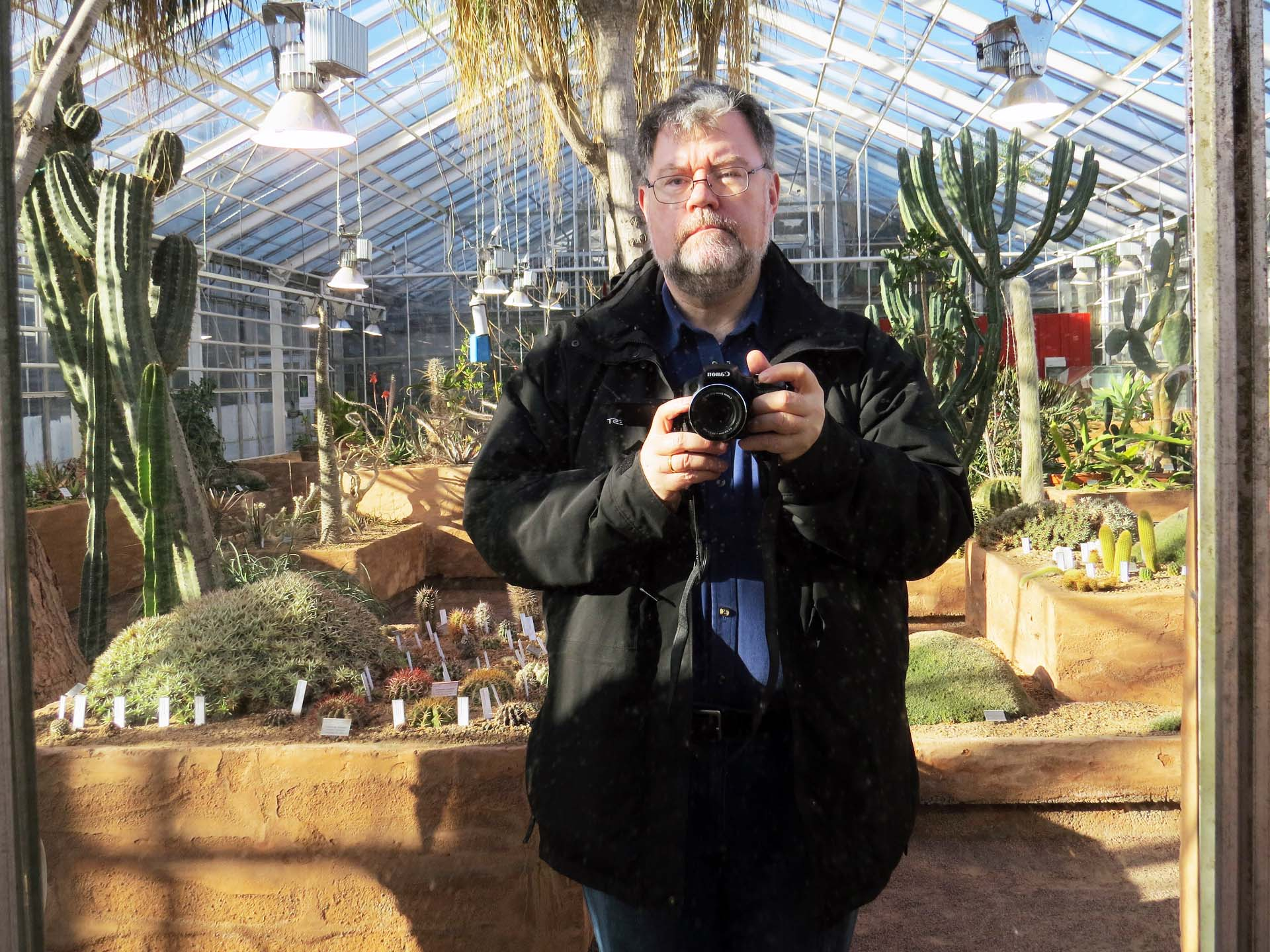 Photographer among the cactuses