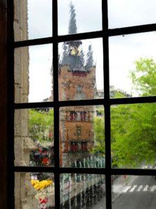 Kortrijk belfry seen through a window of the City hall