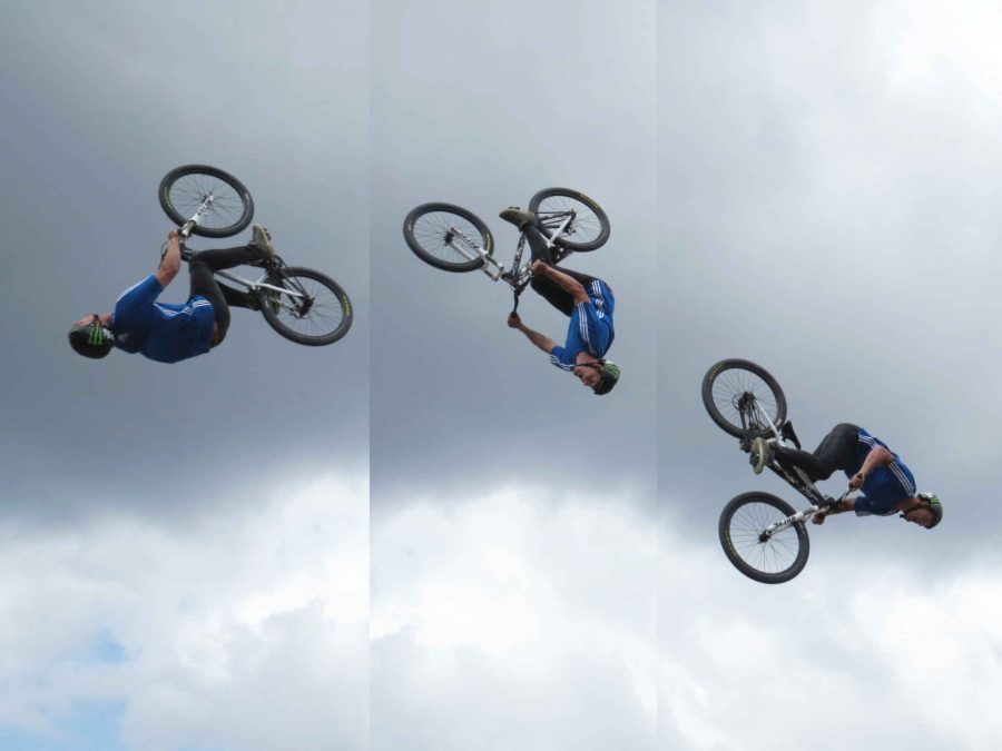 Bicycle jump sequence with rain clouds