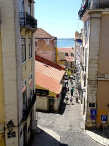 Lisbon street with Tagus beyond