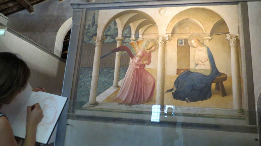 Art student sketching Fra Angelico's Annunciation at San Marco