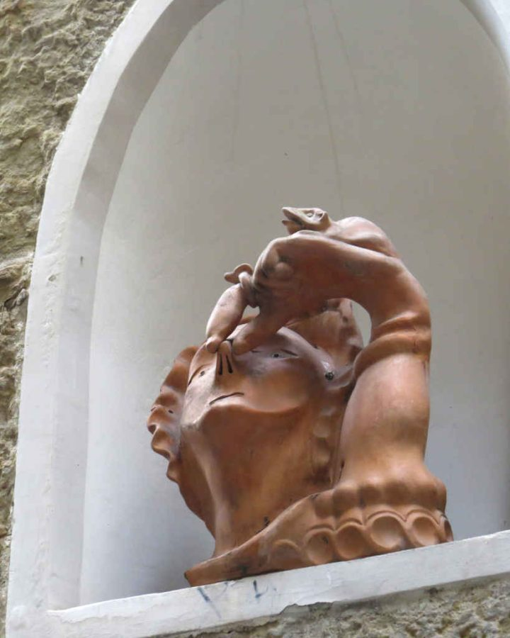 Woman holding her nose