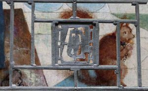 Details - Squirrel behind wrought iron railing