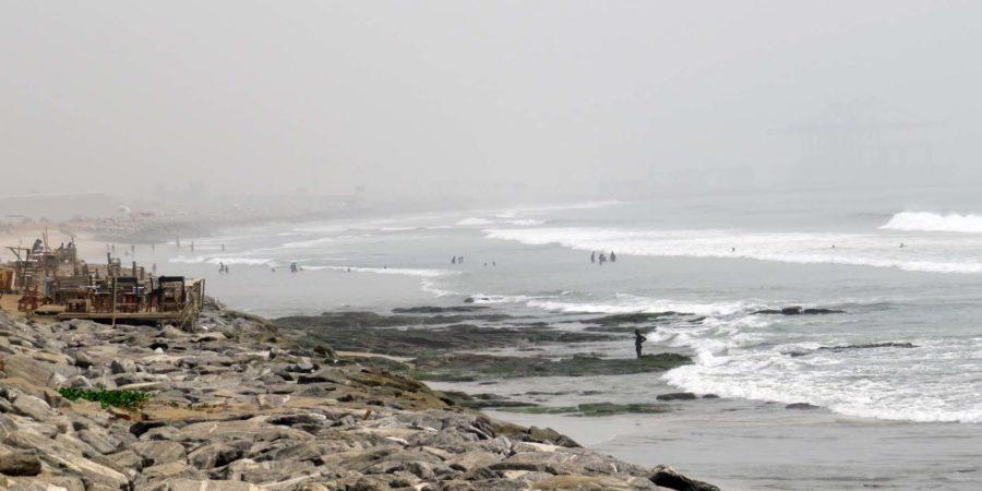 Ghana memories: Tema beach looking back towards Tema Harbour through the Harmattan haze