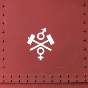Symbol of the Bergslags Järnväg on the side of a heritage carriage
