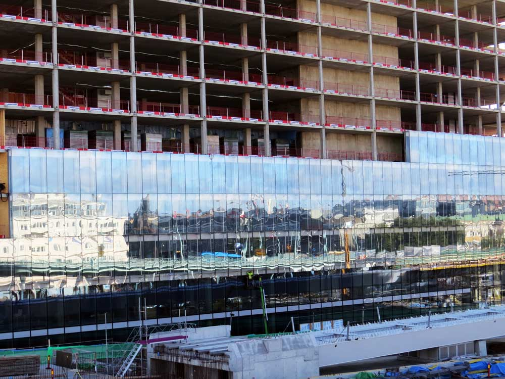 July in photography - Reflecting windows going up on the new building beside the new bridge over Göta Älv