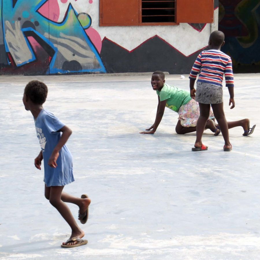 Playing football in the yard at the Jamestown Community Theatre