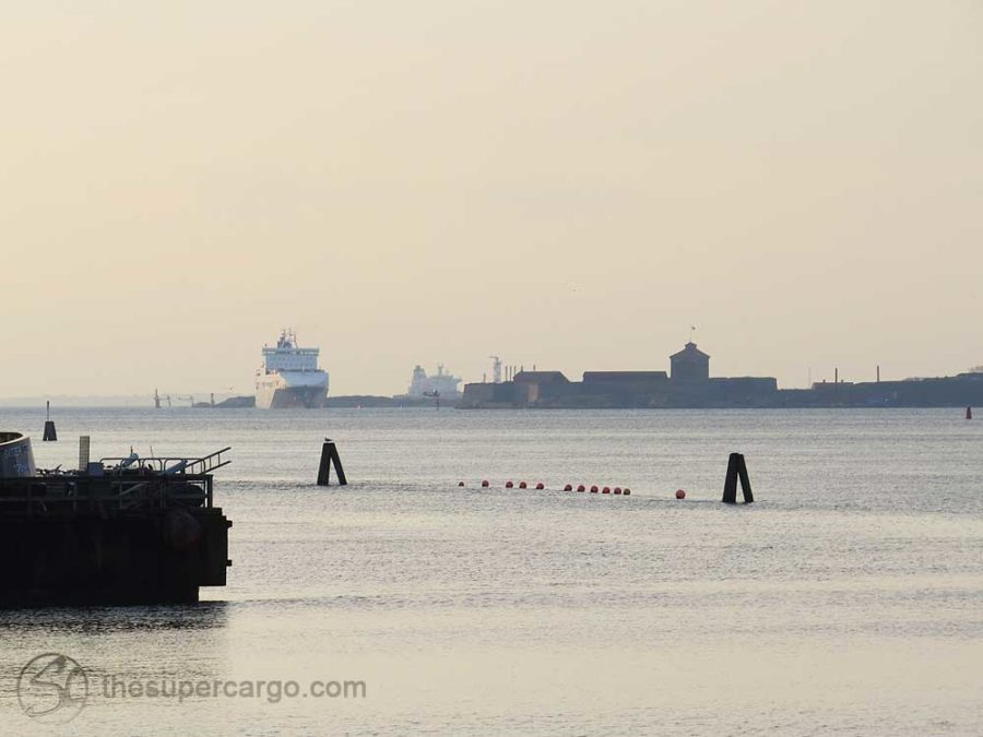 View from Nya Varvet out towards Gothenburg's container port with the Alvsborg Fortress on its island silhouetted in the light