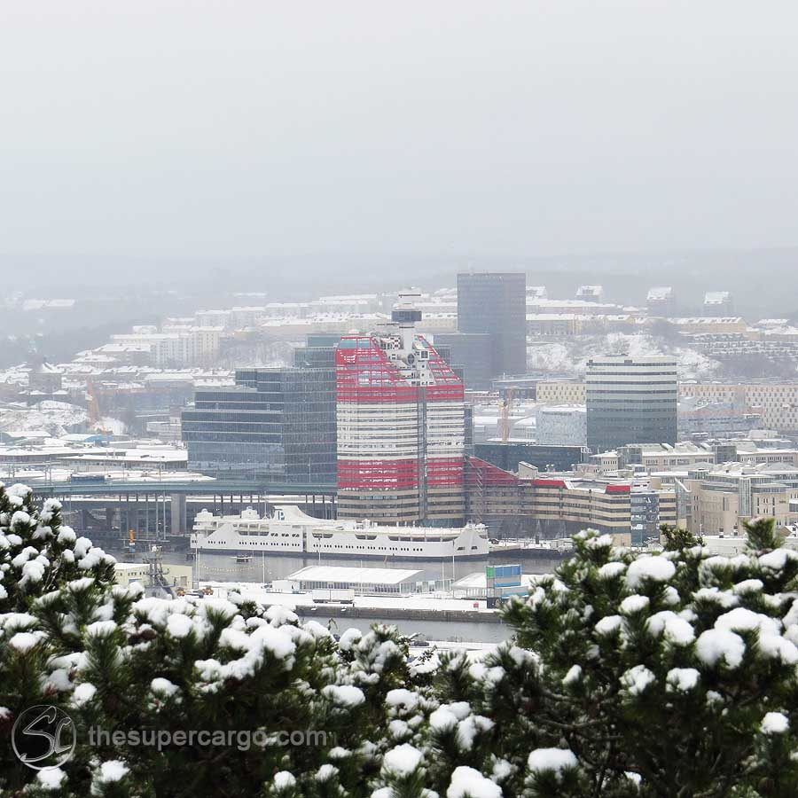 """Snowfall over Gothenburg: The red and white building is popularly known as Läpstiftet - """"The Lipstick""""."""