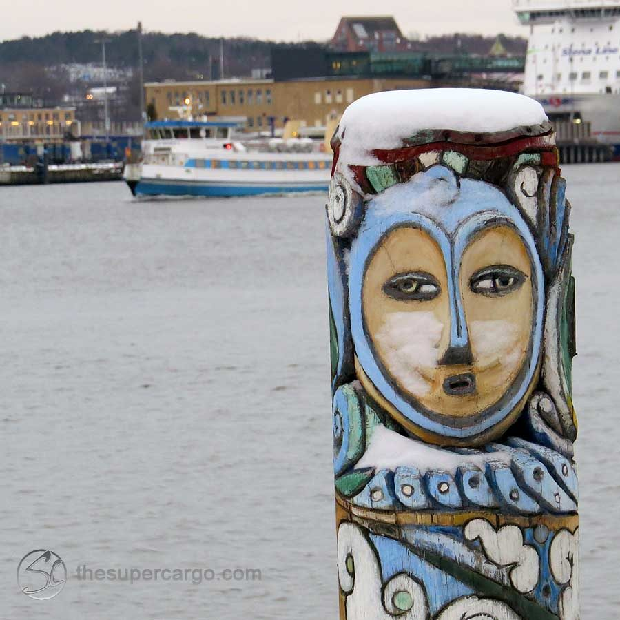 Oriental flavoured river totem with snow frozen on her cheeks