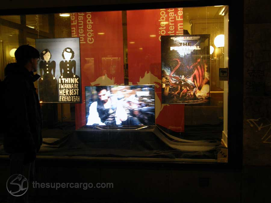 An illuminated display advertising the 2013 Gothenburg International Film Festival in the window of the public transport ticket office at Brunnsparken in the centre of town.