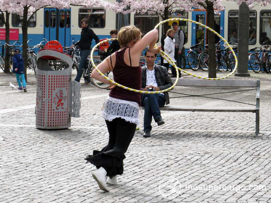 A street performer dancing with hoola hoops on Järntorget on the afternoon of Sunday 12th May 2013